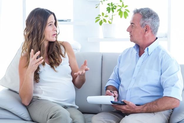 Psychiatrist listning pregenat woman in clinic