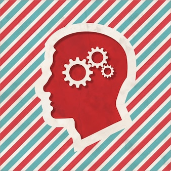 Psychological concept - profile of head with cogwheel gear mechanism - on red and blue striped background. vintage concept in flat design.