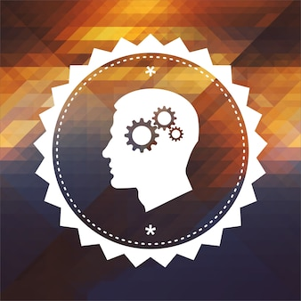 Psychological concept - profile of head with cogwheel gear mechanism. retro label design. hipster background made of triangles, color flow effect.