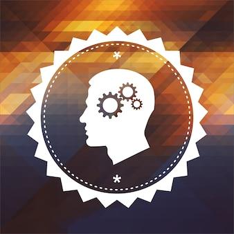 Психологическая концепция - профиль головы с механизмом зубчатого колеса. дизайн ретро этикетки. битник фон из треугольников, эффект цветового потока.