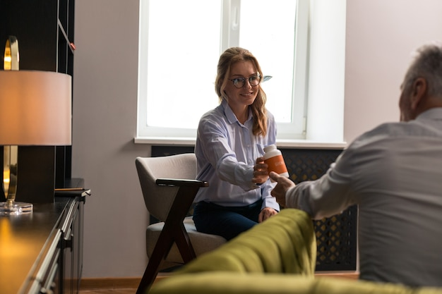 Psychological experiment. female patient and her male psychotherapist swapping roles at the therapy session