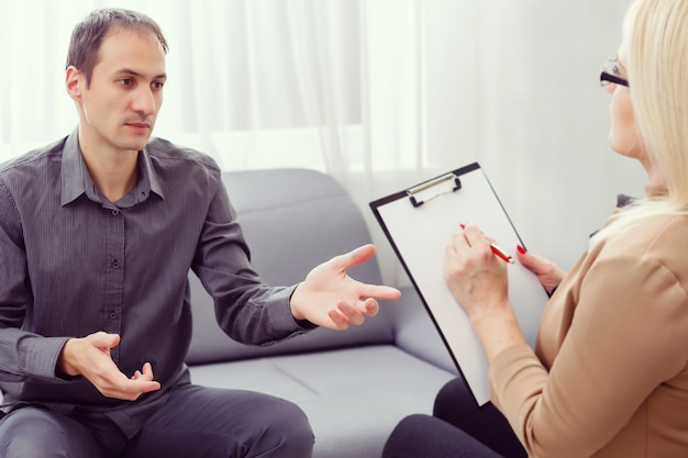 Psychologist having session with her patient in her private consulting room