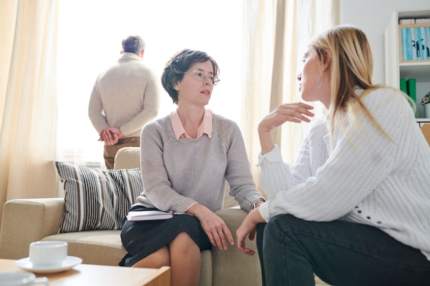 Psychologist listening to anxiety of married woman