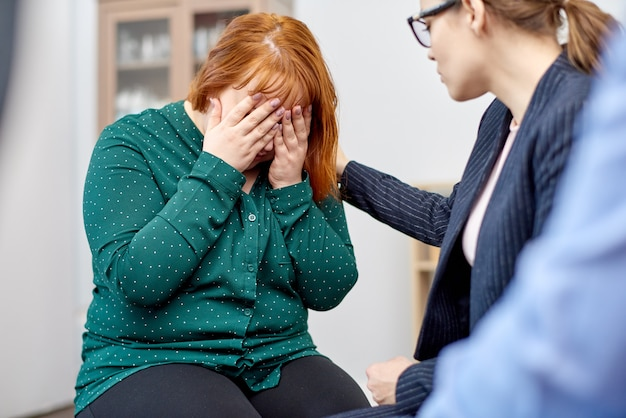 Psychologist supporting female patient