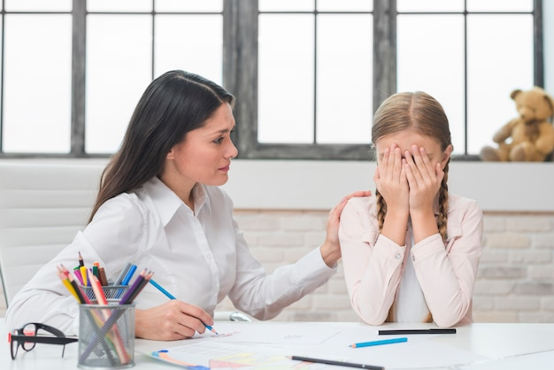 Psychologist supporting girl suffering from depression