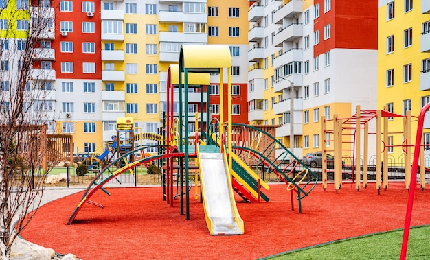 Public colorful children playground for kids activities with new houses on surface
