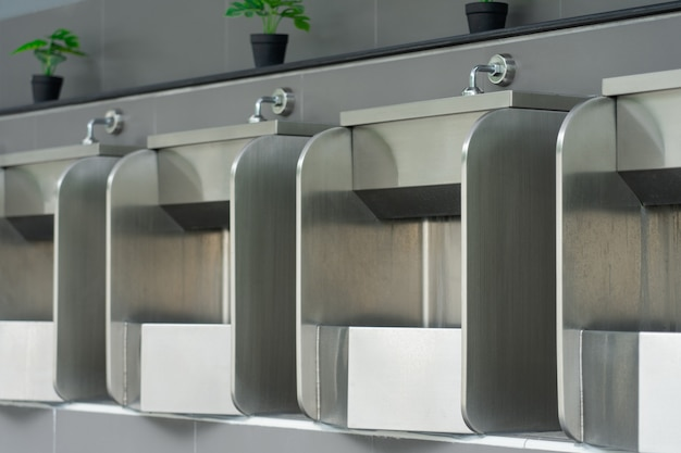 Public male bathroom is made of stainless steel for ease of cleaning