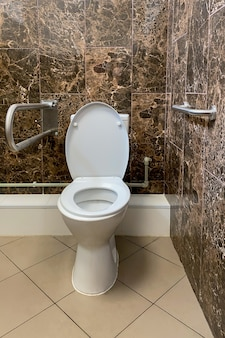 Public restroom for elderly people with special equipment in hospital or retirement home