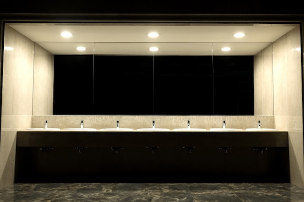 Public toilet and bathroom interior with wash basin