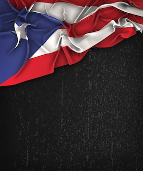 Puerto rico flag vintage on a grunge black chalkboard with space for text