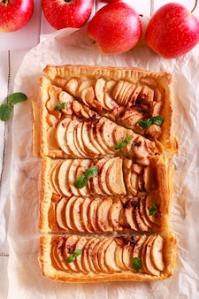 Puff  pastry apple and pear pie on baking paper