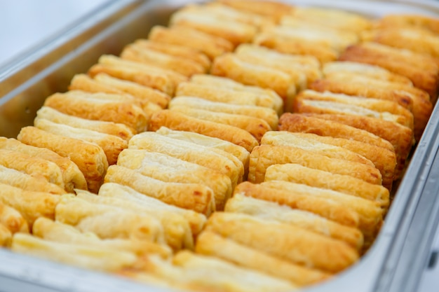 Puff pastry buns in metal container