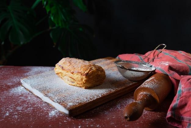 Puff pastry dessert red sievo black background