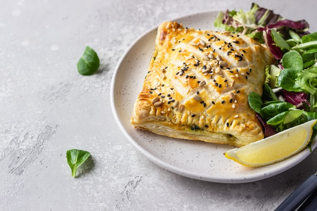 Puff pastry pie with salmon, spinach and ricotta salmon wellington in puff pastry
