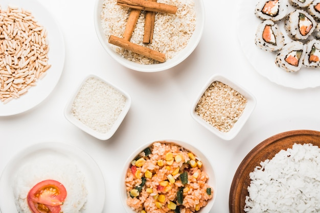Puffed rice; chinese fried rice; sushi and uncooked rice against white background