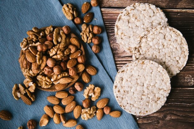 Puffed rice and nuts layout on wooden background