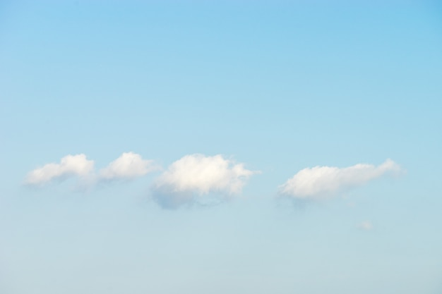 Puffy white clouds against blue sky background