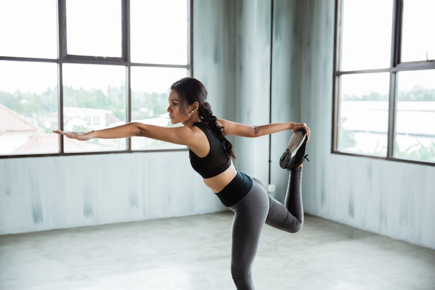 Pull her leg up for warm up exercise