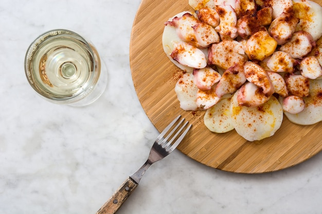 Pulpo a la gallega galician octopus on white marble typical spanish food
