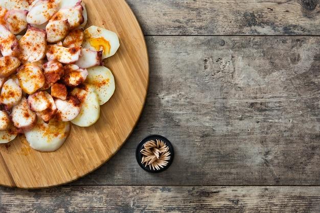 Pulpo a la gallega galician octopus on wood