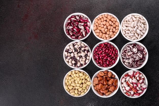 Pulses health food selection in white porcelain dishes.