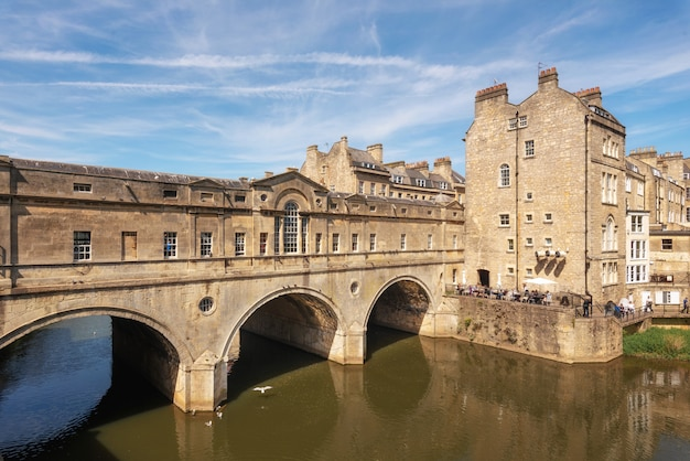 Pulteney bridge and weir on the river avon in the historic city of bath in somerset, england.