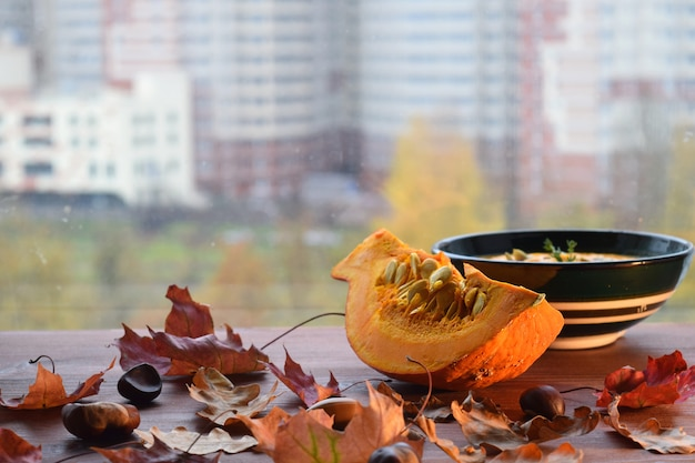 Pumkin soup autumn food maple leaves fall windowsill still life