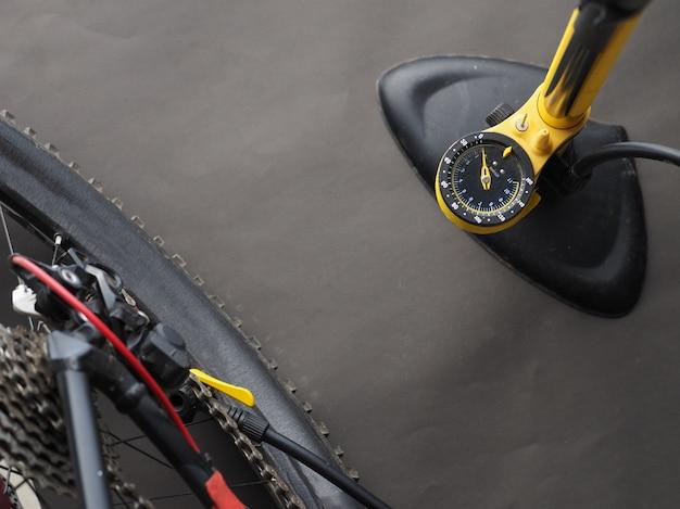Pumping bicycle wheel bicycle pump.
