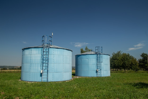 Pumping station on countryside with blue sky