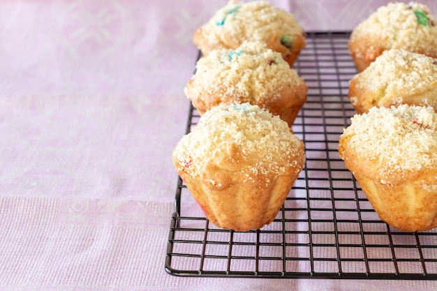 Pumpkin apple oats streusel muffins on cooling rack.