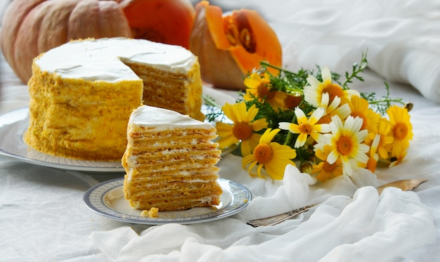Pumpkin cake with cream, many layers