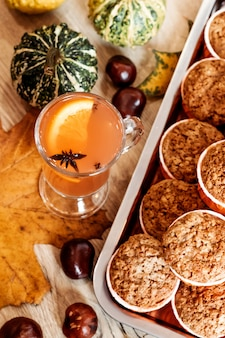 Pumpkin and carrot cupcakes and orange autumn drink. healthy autumn pastries. cafe concept, menu.