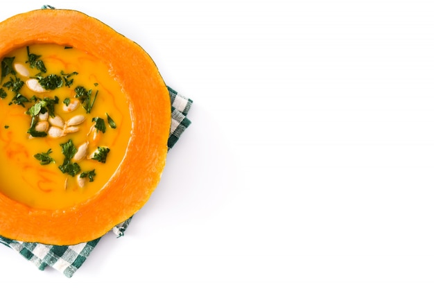 Pumpkin and carrot soup isolated on white.