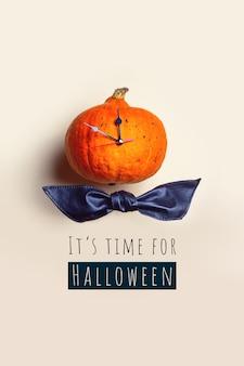 Pumpkin clock shows the time before halloween.