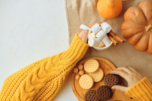 Pumpkin cookies with cups of coffee.