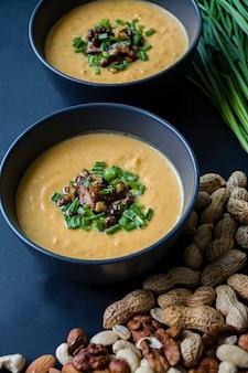 Pumpkin cream soup. dark background.