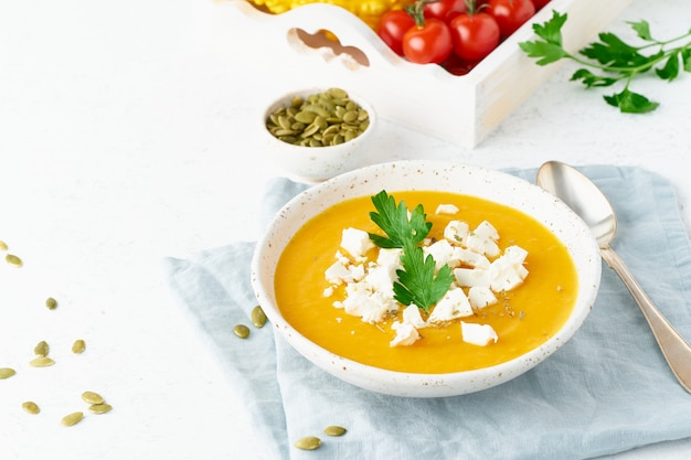 Pumpkin cream soup with feta cheese