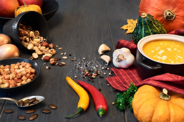 Pumpkin creme soup in a dark ceramic pan