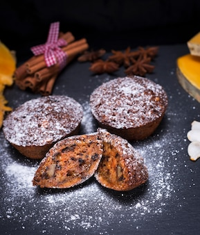 Pumpkin cupcakes are sprinkled with powdered sugar