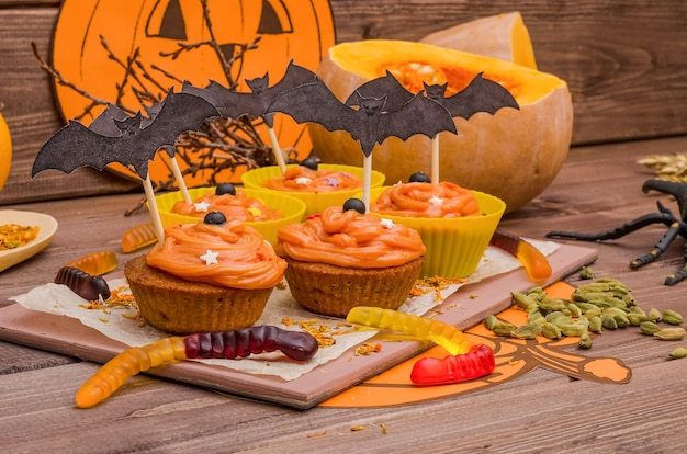 Pumpkin cupcakes with orange cream for halloween. ideas for baking, sweets.