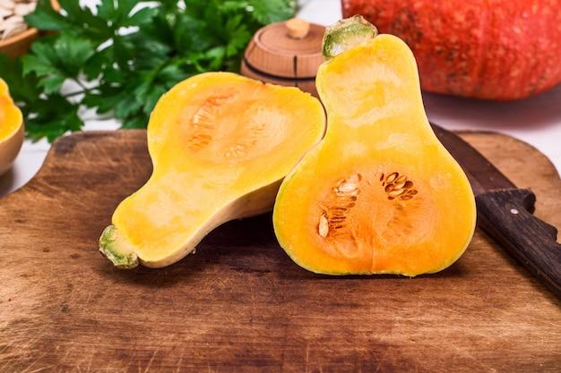 Pumpkin on a cutting kitchen wooden board