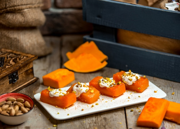 Pumpkin dessert with grated pistachios
