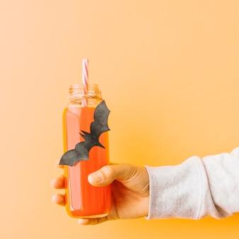 Pumpkin drink in bottle with bat application