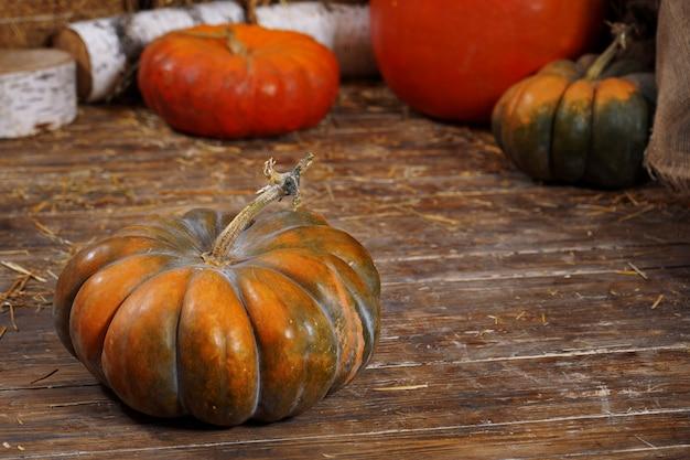 Pumpkin, hay, wooden . background vegetable ribbed orange sleek hay farmer  base rustic  seasonal