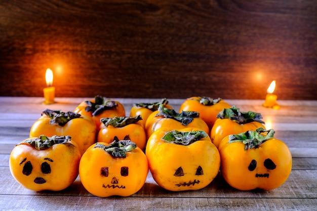 Pumpkin is a group on a wooden floor, a halloween concept.