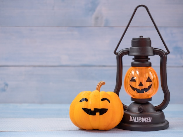 Pumpkin lamp and orange pumpkin decorated with faces. use for halloween concept.