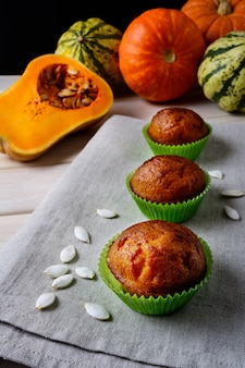 Pumpkin muffins in the green wrappers with squash seeds