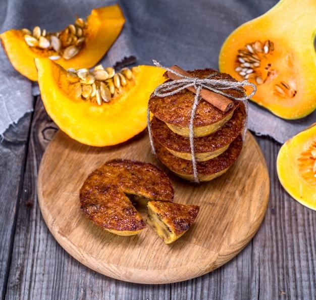Pumpkin muffins on a wooden board