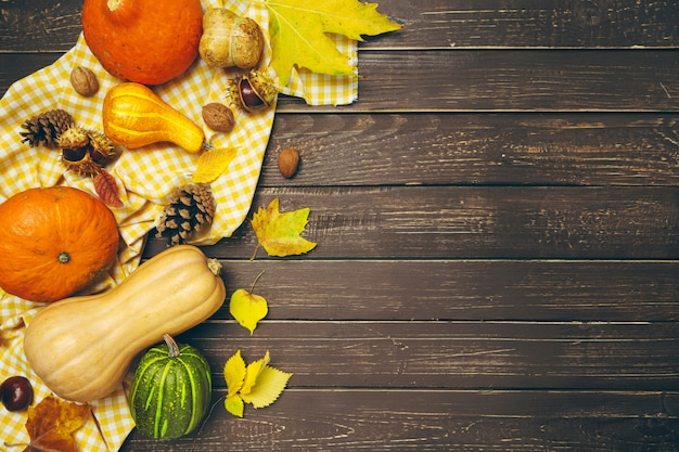 Pumpkin on old rustic wooden table background