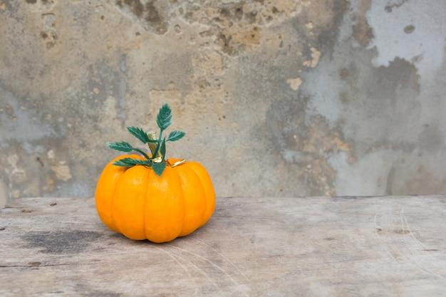 Pumpkin on old wall